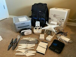 Dji Phantom 4 Pro, 2 Batteries, Backpack, 5 Pairs Of Propellers, Sd Card